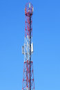 Tower with aerials of cellular on a background blue sky Stock Images