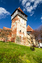 Tower of alma vii transylvania romania medieval scenery with fortified churches rural church was built in th century by saxons in Royalty Free Stock Photography