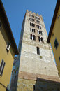 The tower of the basilica of san frediano lucca italy has openings that graduate in number typical italian and spanish romanesque Royalty Free Stock Images
