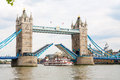 Tower bridge london england raised to let ship pass through Stock Images