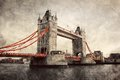 Tower bridge in london england the uk artistic vintage retro style with red elements Stock Photography