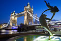 Tower bridge in london the magnificent and girl with a dolphin statue Stock Photography