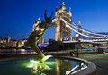 Tower bridge in london the magnificent and girl with a dolphin statue the shard can be seen the background Royalty Free Stock Images