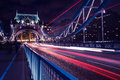 Tower Bridge London at night with traffic light trails Royalty Free Stock Photo