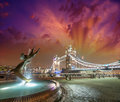 Tower bridge and st katharine docks girl with dolphin fountain beautiful sunset in london Stock Images