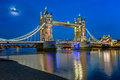 Tower Bridge and Thames River Lit by Moonlight at the Evening