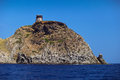 Tower on capraia island elba from the sea tuscany italy europe Royalty Free Stock Photography