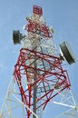 Tower with cell phone antenna system against blue sky Stock Images
