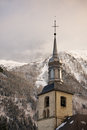 Tower church chamonix village winter sunset france Royalty Free Stock Photo