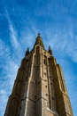 Tower of the church of Our Lady in Bruges on a beautiful day, Belgium Royalty Free Stock Photo
