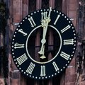 Tower clock of the cathedral of Frankfurt shows 2 minutes past twelve Royalty Free Stock Photo
