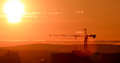 Tower crane against the backdrop of the setting sun. Backlight. Ekaterinburg, Russia