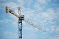 Tower crane and the blue sky in bright day Royalty Free Stock Photo