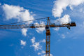 Tower crane clouds and blue sky yellow against the background of white Stock Image