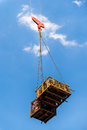 Tower crane lift the iron Stock Image
