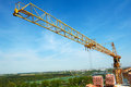 Tower crane over blue sky two buildings construction cranes site Royalty Free Stock Photo
