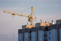 Tower crane and reinforced building under construction Royalty Free Stock Photos