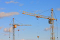 Tower cranes image with blue sky stock photo and yellow crane on white clouds background Royalty Free Stock Images