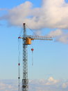 Tower cranes image with blue sky stock picture and black yellow crane on white clouds background Royalty Free Stock Photos