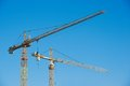 Tower cranes over blue sky two buildings construction site Royalty Free Stock Photography