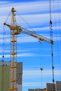 Tower cranes picture with blue sky stock photo and yellow crane on white clouds background Royalty Free Stock Image