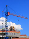 Tower cranes picture with blue sky stock photo and yellow crane on white clouds background Stock Photos