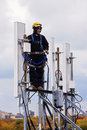 Tower crew leader working with the cellular antennas Royalty Free Stock Photo