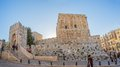 Tower of david at sunset jerusalem israel february priest and tourists passing by the it is an ancient citadel located near the Royalty Free Stock Image