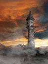 Tower in fantasy world with smoke on ground Royalty Free Stock Photos