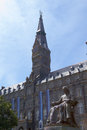 Tower of georgetown university with the statue of john carroll was founded by carrol in Royalty Free Stock Photos