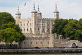 Tower of london england the castle at the shore the thames river with its four towers and fortified walls Royalty Free Stock Photos