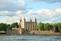 The tower of london fortress in the evening light with white clo across water clouds Stock Photos