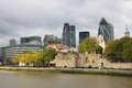 Tower of london and modern london city office skyline by river thames offices in business district along near the bridge the Royalty Free Stock Photography