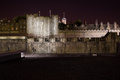 Tower of london at night the next to the river thames was used as a prison by english kings but is now a tourist attraction Stock Photography