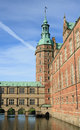 Tower and moat of castle of Frederiksborg castle Royalty Free Stock Photo