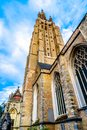The tower of Onze Lieve Vrouwekerk Church of Our Lady in the medieval city of Bruges, Belgium Royalty Free Stock Photo