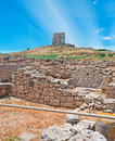 Tower over ruins san giovanni seen from tharros archeological site Royalty Free Stock Image