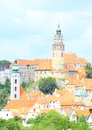 Tower of palace in cesky krumlov and red roofs old houses town czech republic Royalty Free Stock Photos
