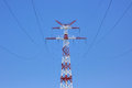 Tower of power line on against blue sky. Royalty Free Stock Photo