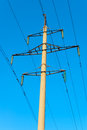 Tower of power transmission line on background blue sky Stock Photo