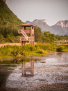 Tower and reflect in the marsh moutain background Royalty Free Stock Photo