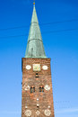 Tower and spire aarhus cathedral denmark evening sun makes the elegant of glow glitter golden clock green copper red brick masonry Royalty Free Stock Images