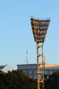 Tower with spotlights towers and floodlights to illuminate the night games at the stadium Stock Photo
