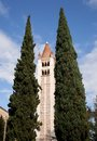 Tower of st zeno s verona guarded by cypress trees the in stands as it has for over a years looking over the city italy Stock Images