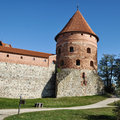 Tower of trakai castle lithuania island in one the most popular touristic destinations in with trees and blue sky Stock Images