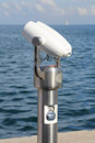 Tower viewer coin operated binoculars on a stalk near sea Royalty Free Stock Photos
