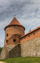 Tower and wall of the trakai red brick castle in lithuania Royalty Free Stock Images
