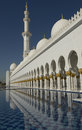 Tower, water pool and arches at the stunning Sheikh Zayed Grand Mosque in Abu Dhabi UAE Royalty Free Stock Photo
