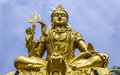 Towering golden statue of Deity Shankar Royalty Free Stock Images