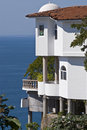 Towering residence overlooking the Pacific ocean Stock Photos
